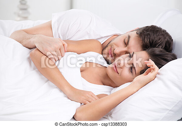Young adult couple in bedroom - csp13388303