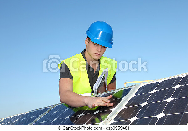 Young adult doing professional training on solar panels plant - csp9959481