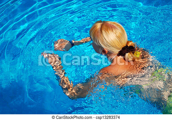 Young Adult Girl Swimming in the Pool - csp13283374