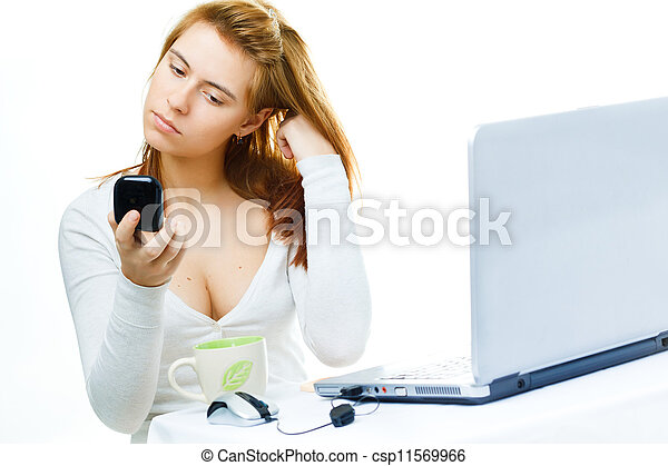 young adult red haired business lady  over white frustrated with her computer - csp11569966