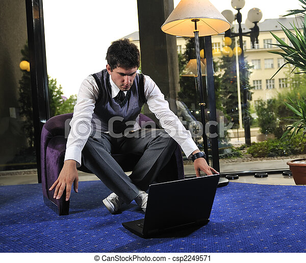 young adult working on laptop - csp2249571