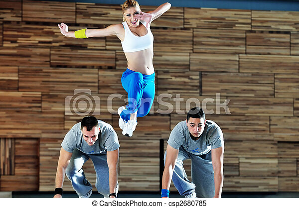 young adults group in fitness club - csp2680785