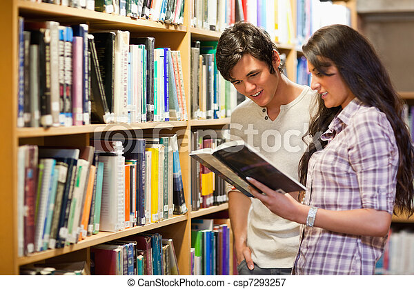 Young adults reading a book - csp7293257