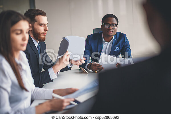 Young African American Business Man leading a team - csp52865692