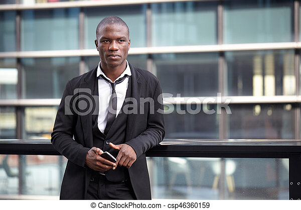 young african american businessman using smart phone - csp46360159