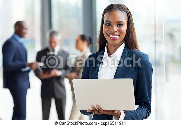 young african american businesswoman using laptop computer - csp16511911