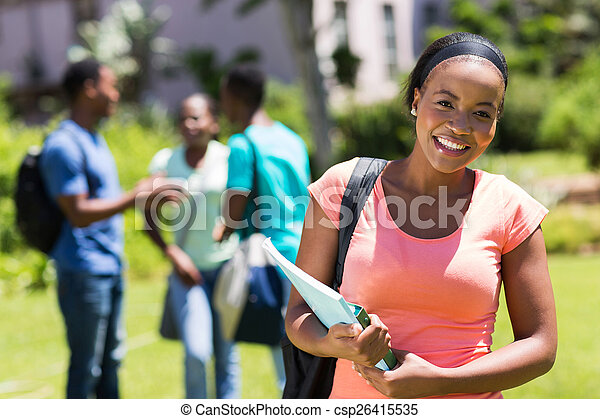 young African American college woman holding books - csp26415535