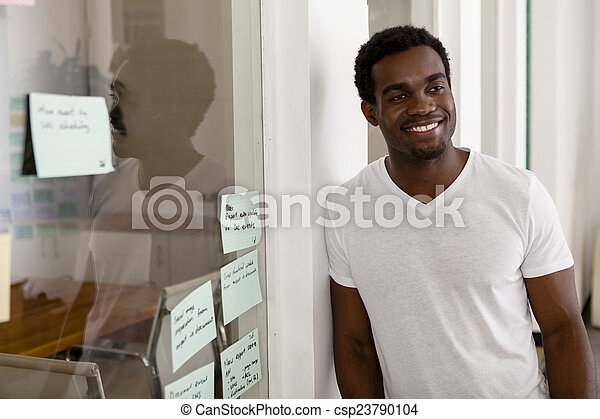 Young African American entrepreneur in his startup office - csp23790104