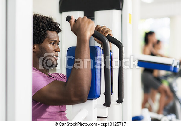 Young african american man training in fitness gym - csp10125717