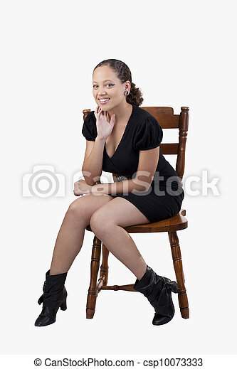 Young African American Woman Black Dress Sitting - csp10073333
