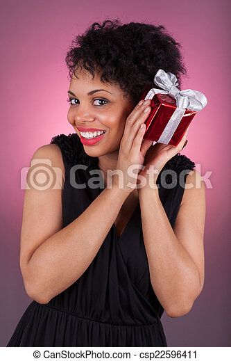 Young African American woman holding a gift - csp22596411