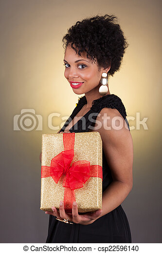 Young African American woman holding a gift - csp22596140