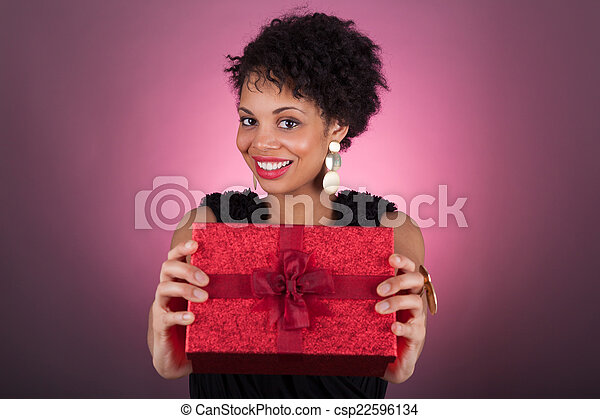 Young African American woman holding a gift - csp22596134
