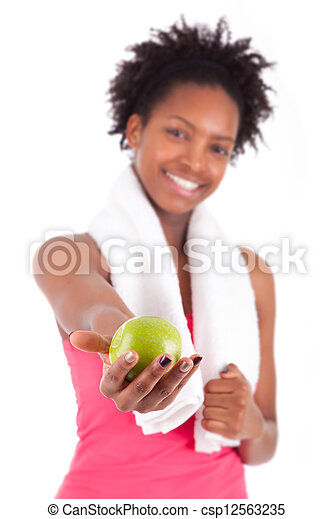Young african american woman holding an apple - csp12563235