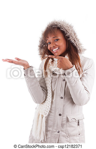 Young african american woman holding something - csp12182371