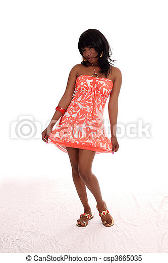 Young African American woman in orange dress - csp3665035