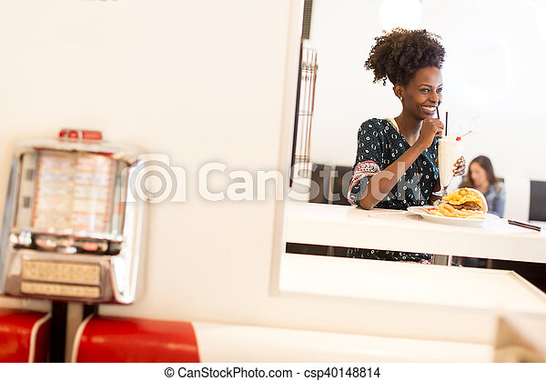 Young african american woman in the diner - csp40148814