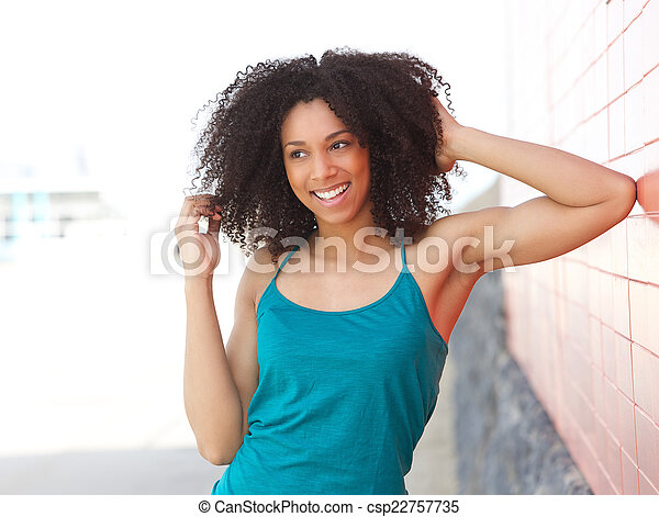 Young african american woman laughing outdoors - csp22757735