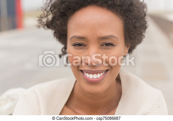 Young African American woman looking at camera - csp75086687