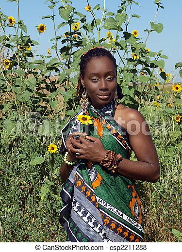 Young African American woman outdoors in native dress - csp2211288