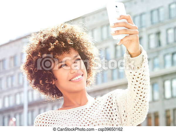 Young african american woman posing outdoor. - csp39650162