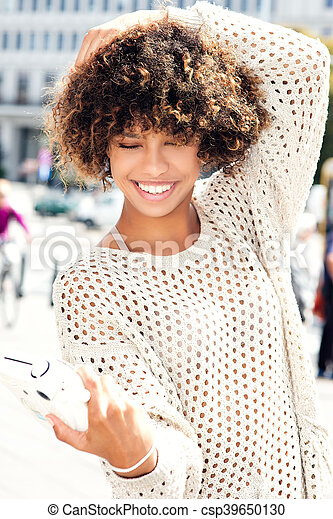 Young african american woman posing outdoor. - csp39650130