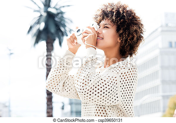 Young african american woman posing outdoor. - csp39650131