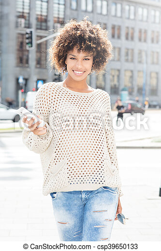 Young african american woman posing outdoor. - csp39650133