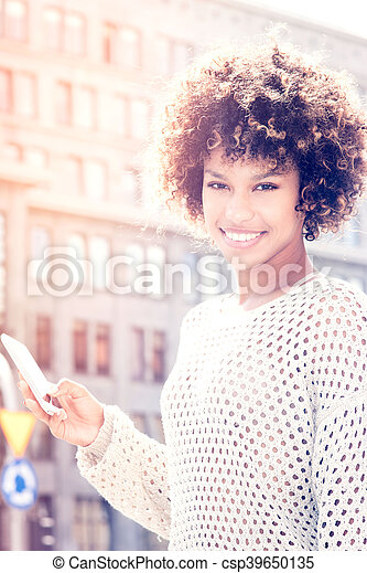Young african american woman posing outdoor. - csp39650135