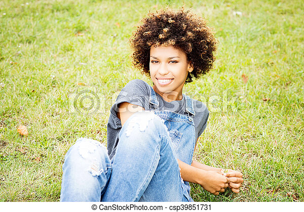 Young african american woman posing outdoor. - csp39851731