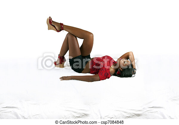 Young African American woman reclining on back - csp7084848