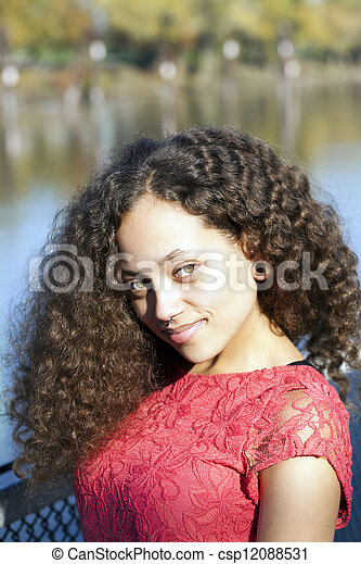 Young African American Woman Red Dress Outdoors - csp12088531