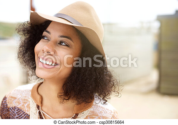 Young african american woman smiling with hat - csp30815664