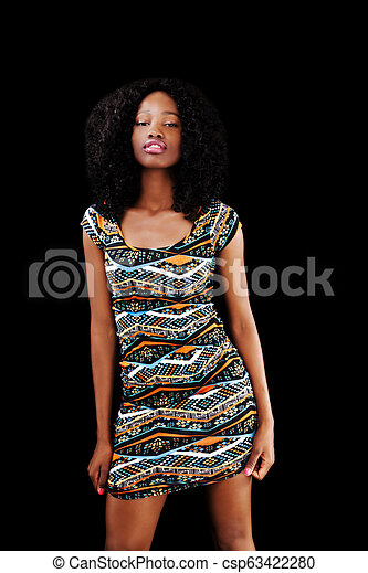 Young African American Woman Standing In Dress Black Background - csp63422280
