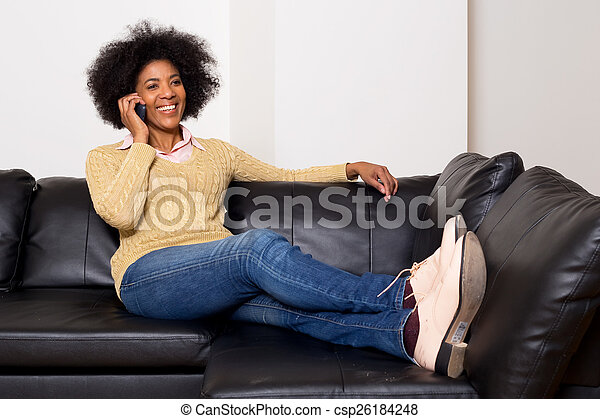 young african american woman talking on the phone. - csp26184248