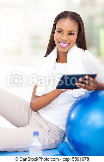 young african american woman using tablet computer - csp15891078