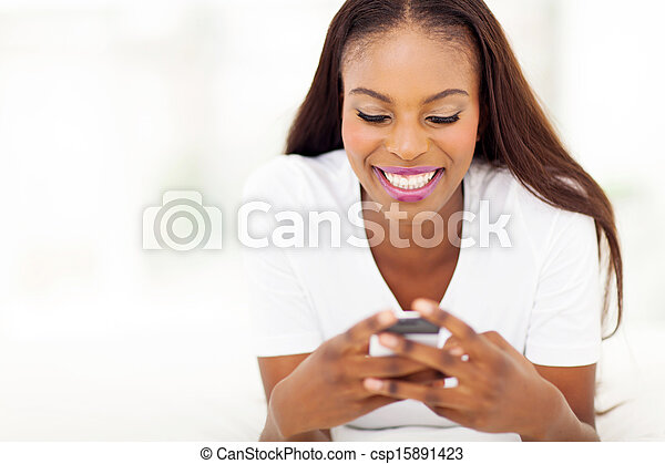 young african american woman using smart phone - csp15891423