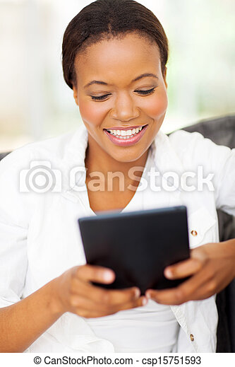 young african american woman using tablet computer - csp15751593