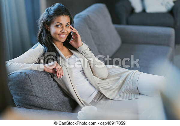 young african american woman with smartphone at home - csp48917059