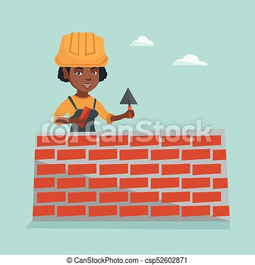 Young african bricklayer building a brick wall. - csp52602871