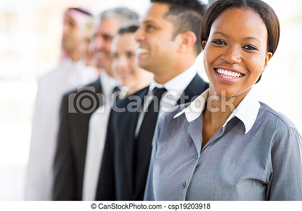 young african businesswoman with business team - csp19203918