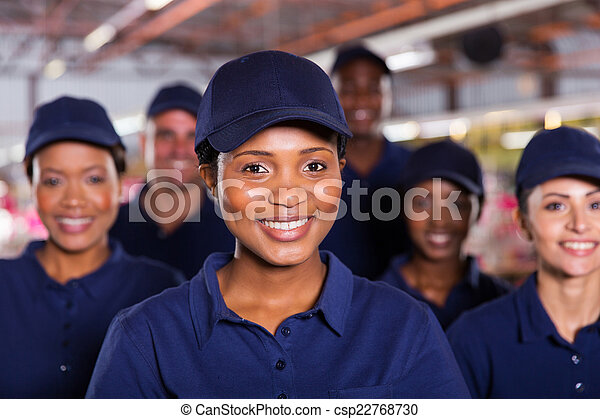 young african factory worker with colleagues - csp22768730