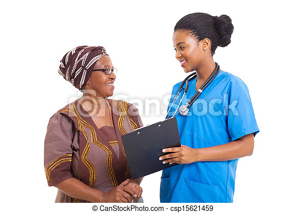young african nurse helping senior woman with medical form - csp15621459