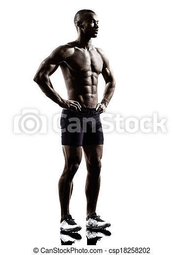 young african shirtless muscular build man standing silhouette - csp18258202
