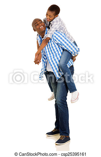 young african woman piggybacking on her boyfriend - csp25395161
