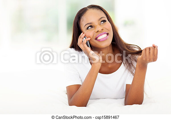 young african woman talking on cell phone - csp15891467