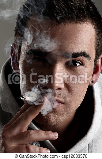 Young and handsome man smoking - csp12033570