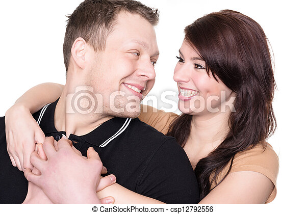 Young and happy couple in front of white background - csp12792556