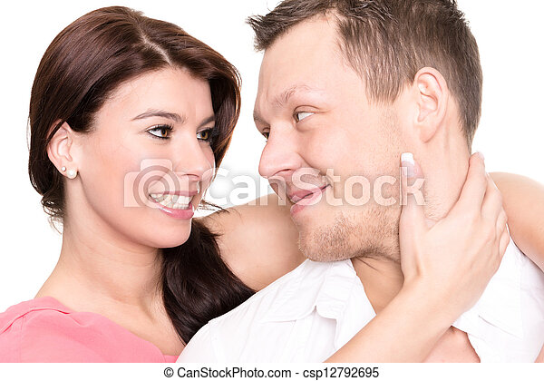 Young and happy couple in front of white background - csp12792695