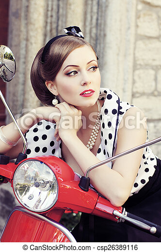 Young and sexy woman with her motor scooter - retro style image. - csp26389116